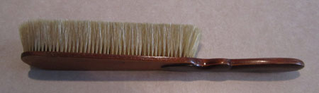 80 year old clothing brush