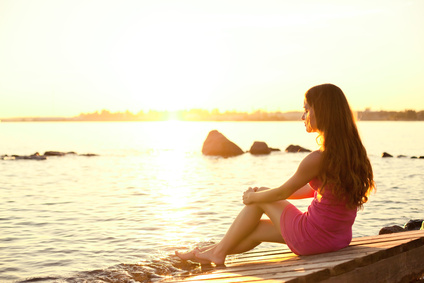Peaceful woman on the beach