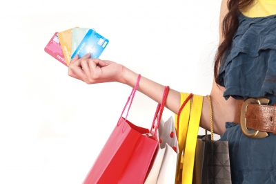 Woman with shopping bags and credit cards