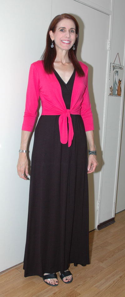 Black maxi-dress with pink cardigan